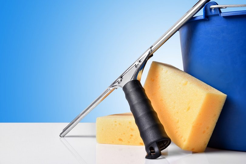 Window-cleaning-tools-on-white-table-squeegee_Davizro-Photography_shutterstock