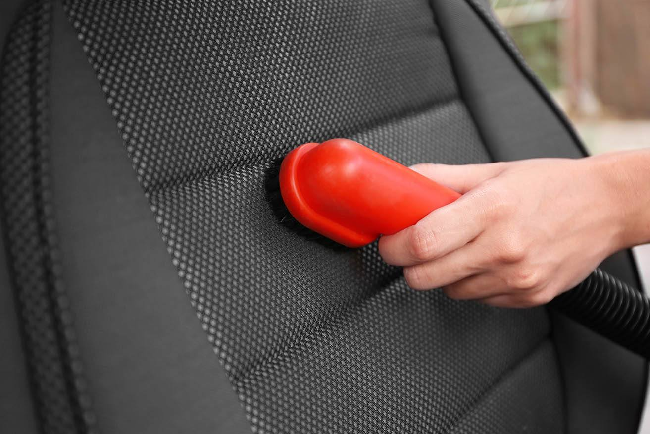 hand cleaning car seat