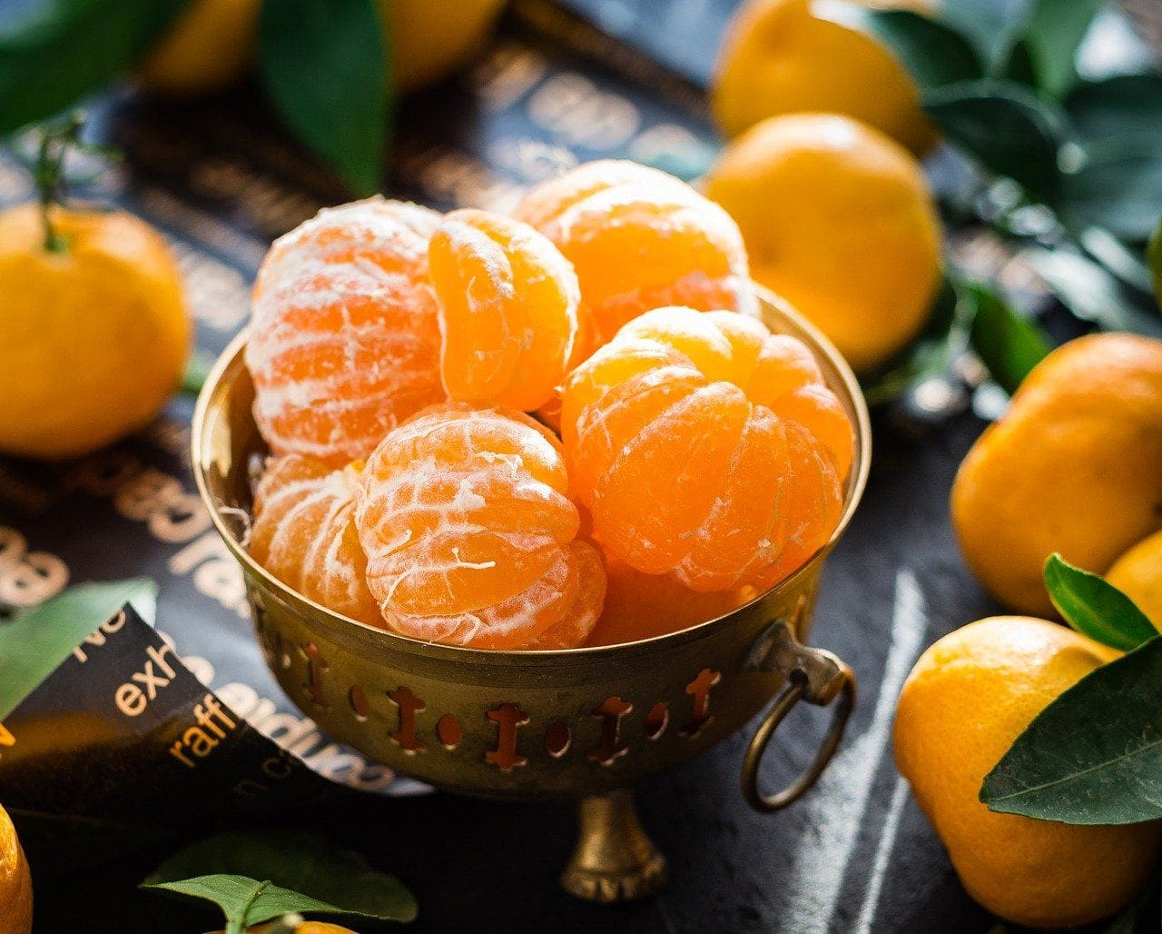 peeled mandarin oranges in a cup