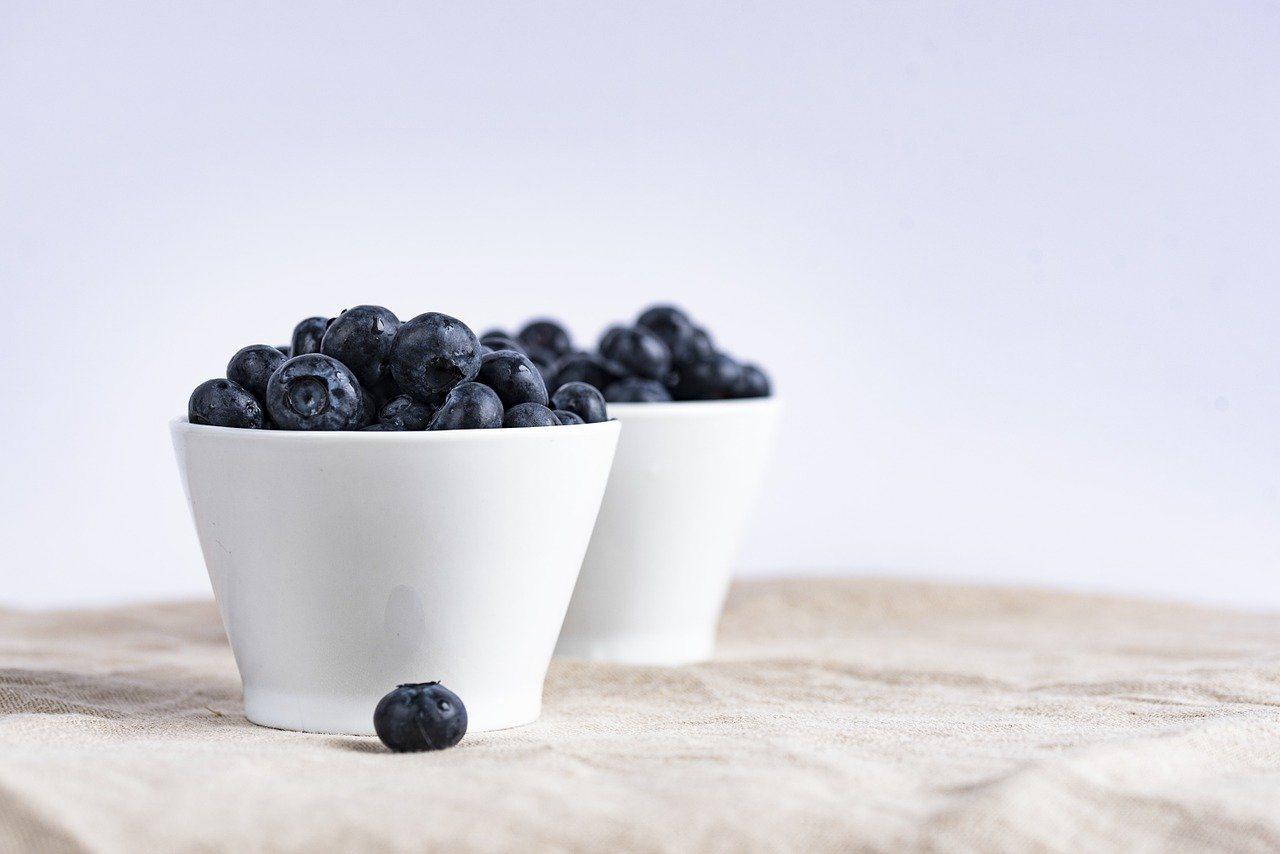 two bowls of blueberries