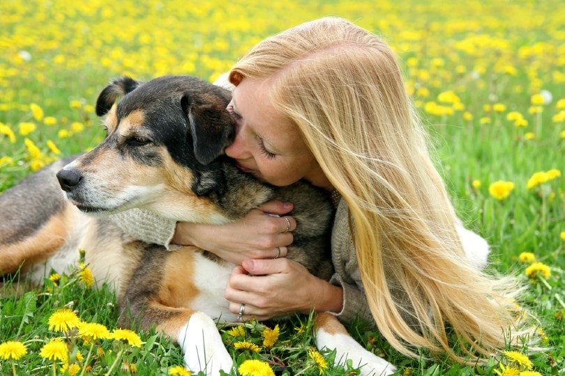 woman hugging dog_Christin Lola, Shutterstock