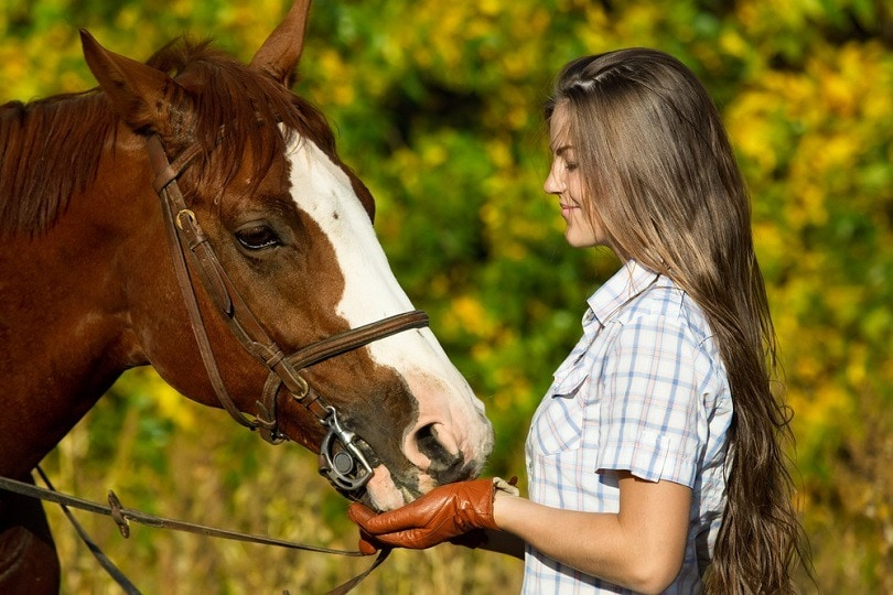 pretty-young-woman-with-a-browne-horse_Wallenrock_shutterstock