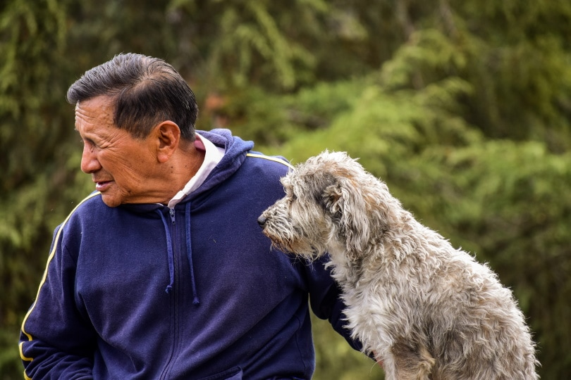 pet owner and his dog in the park