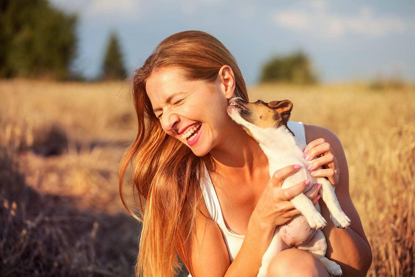 Dog licking woman's ear